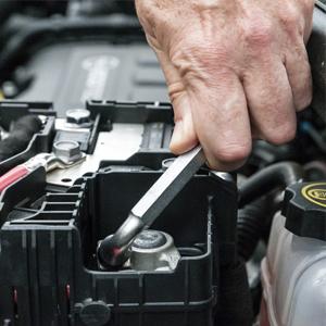 mechanic attaching battery
